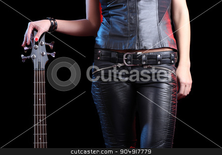 Sexy girl in leather clothes with bass guitar stock photo, Sexy girl in leather clothes with bass guitar. rock by Kopytin Georgy