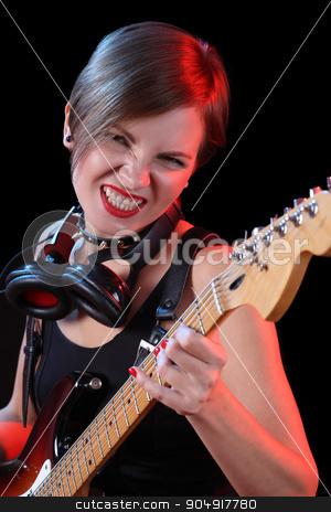 Rock star holding her electric guitar. sexy girl stock photo, Rock star holding her electric guitar. headphones by Kopytin Georgy