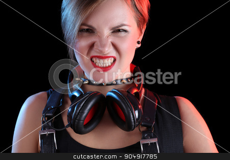 Expressive girl in headphones stock photo, Expressive girl in headphones with studded collar by Kopytin Georgy