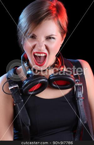 Expressive girl in headphones stock photo, Expressive girl in headphones with studded collar by Kopytin Georgy