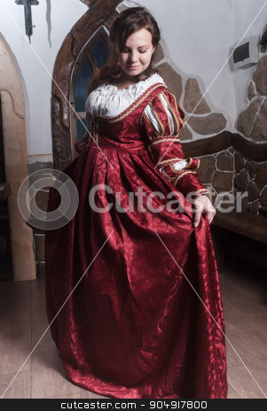 Portrait of elegant woman in medieval era dress stock photo, Portrait of young attractive woman in dress of retro baroque style by Aikon