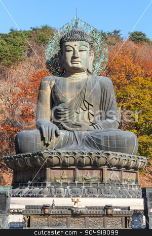 statue of buddha in Seoraksan National Park ,Korea stock photo, statue of buddha and colorful of tree in autumn at old temple in Seoraksan National Park ,Korea by stockdevil