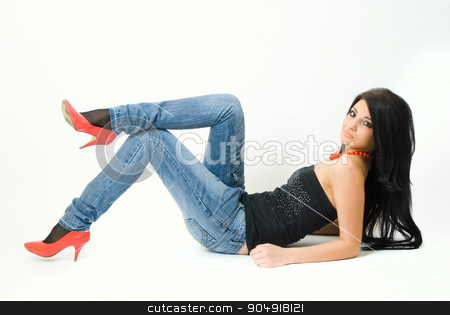 Attractive young woman with long hair on floor stock photo, Beautiful girl with long hair lying on the floor over white background by Aikon