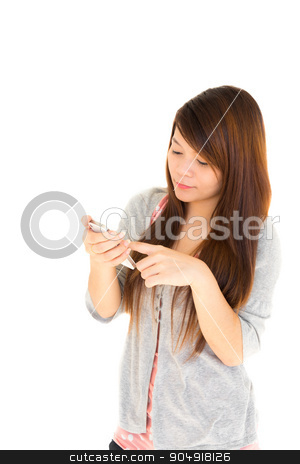woman play mobile phone stock photo, Asian woman is playing mobile phone and chat with someone on white background (isolated) by stockdevil