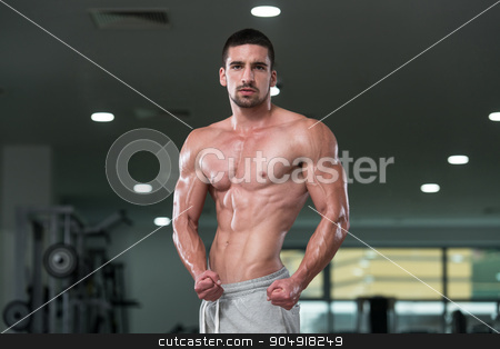 Mens Health stock photo, Awesome Bodybuilder Showing His Muscles And Posing In Gym by Jasminko Ibrakovic