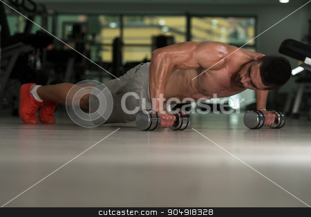 Pushups With Dumbbels stock photo, Young Athlete Doing Pushups With Dumbbells As Part Of Bodybuilding Training by Jasminko Ibrakovic