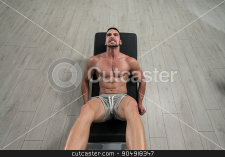 Health Club Leg Press Machine stock photo, Young Man Using The Leg Press Machine At A Health Club In Gym by Jasminko Ibrakovic