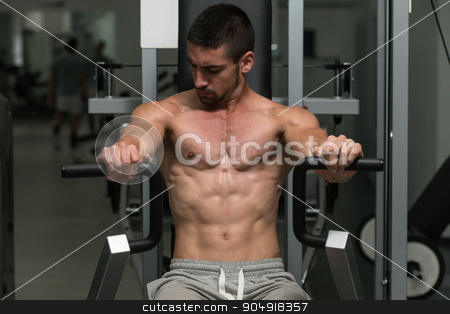 Chest Exercises On A Machine stock photo, Young Bodybuilder Doing Heavy Weight Exercise For Chest by Jasminko Ibrakovic