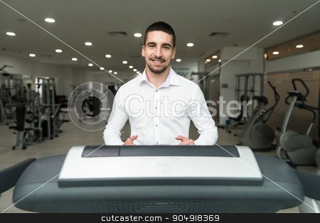 Businessman Exercising On A Treadmill stock photo, Businessman Running On Treadmill At A Health Club by Jasminko Ibrakovic