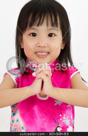 Chinese Little Girl wearing Cheongsam with greeting gesture stock photo, Chinese Little Girl wearing Cheongsam with greeting gesture in plain white background. by Tan Kian Khoon