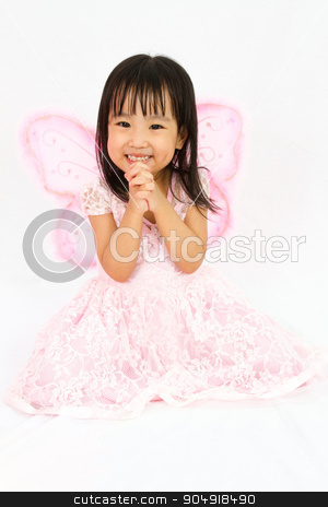 Chinese little girl wearing butterfly custome with praying gestu stock photo, Chinese little girl wearing butterfly custome with praying gesture in plain white background by Tan Kian Khoon