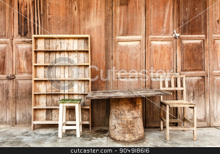 Wooden table,chairs,shelf in front of wooden house  stock photo, Wooden table,chairs,shelf in front of wooden house (rural scene) at Chiang Khan ,Thailand by stockdevil