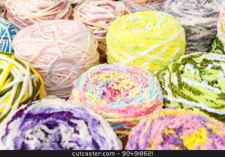 knitting wool stock photo, close up to group of colorful knitting wool by stockdevil