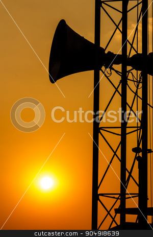loudspeaker and sunset stock photo, loudspeaker on pillar and sunset in the evening (silhouette) in Thailand by stockdevil