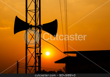 loudspeaker and sunset stock photo, loudspeaker on metal pillar above roof of house in twilight time at Thailand (silhouette style) by stockdevil