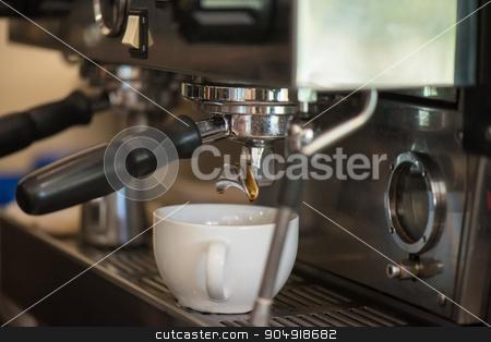 preparing coffee in cafe stock photo, preparing coffee in coffee shop with professional coffee machine by olinchuk