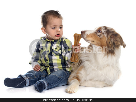 little boy and dog stock photo, little boy and dog in front of white background by Bonzami Emmanuelle