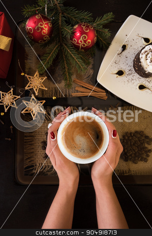 new year coffee stock photo, Hands holding mug of coffee close-up, on new year background by olinchuk