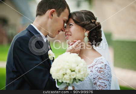 Close up wedding couple. Sincere look of bride stock photo, Close up wedding couple. Sincere look of bride by Andrii Shevchuk