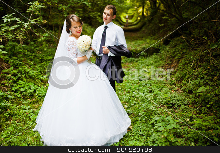 Wedding couple at green alley  stock photo, Wedding couple at green alley  by Andrii Shevchuk