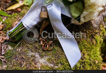 Wedding bouquet with lock at moss stock photo, Wedding bouquet with lock at moss by Andrii Shevchuk
