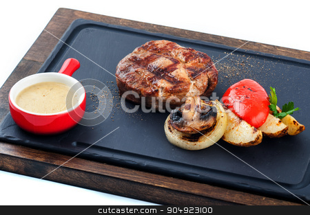 Grilled beef steak on wooden pan. stock photo, Isolated grilled beef steak on wooden pan. by agnormark
