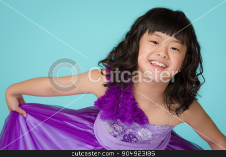 Young Japanese Girl Portrait stock photo, A portrait of a cute, happy and young Japanese girl in a purple dress on a blue background. by Scott Dumas