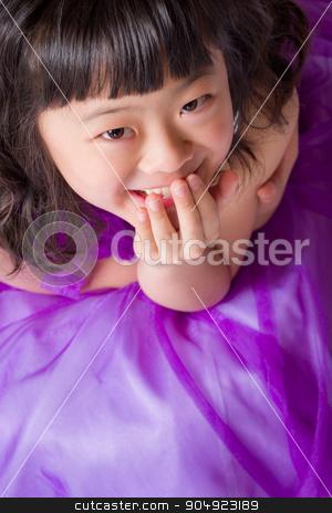 Young Japanese Girl Portrait stock photo, A portrait of a cute, happy and young Japanese girl in a purple dress. by Scott Dumas