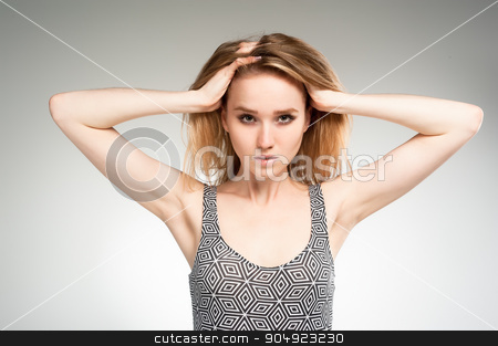 Attractive sad woman over white stock photo, Young beautiful fashionable deplorable model in gymnastic suit over white background by Aikon