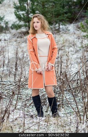 Winter portrait of the girl. stock photo, Winter portrait of the girl. a bright orange coat. by oleksandrmasnyi