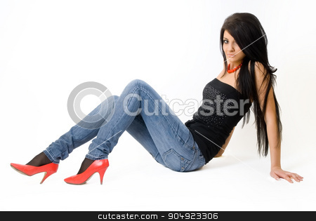 Attractive young woman with long hair on floor stock photo, Beautiful girl with long hair sitting on the floor over white background by Aikon