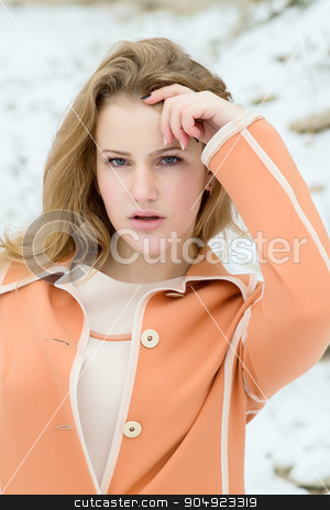 Winter portrait of the girl. stock photo, Winter portrait of the girl. a bright orange coat. by oleksandrmasnyi