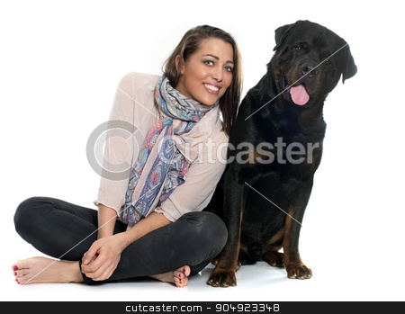 woman and rottweiler stock photo, woman and rottweiler in front of white background by Bonzami Emmanuelle