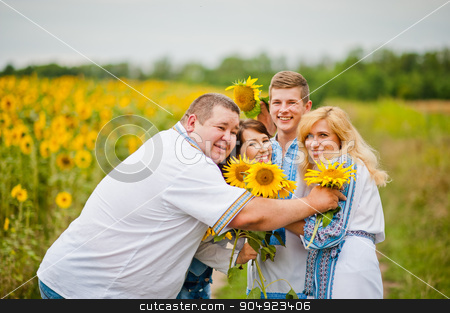 Happy family having fun on sunflowers stock photo, Happy family having fun on sunflowers by Andrii Shevchuk