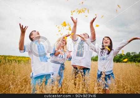 Happy family having fun on field stock photo, Happy family having fun on field by Andrii Shevchuk