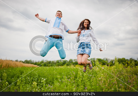 Brother with sister having fun on field stock photo, Brother with sister having fun on field by Andrii Shevchuk