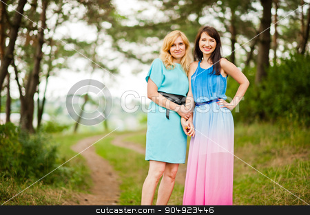 Happy family. Young mother and daughter at pine forest stock photo, Happy family. Young mother and daughter at pine forest by Andrii Shevchuk