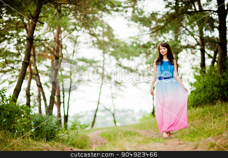 Young beautiful and cute girl posed at pine forest stock photo, Young beautiful and cute girl posed at pine forest by Andrii Shevchuk