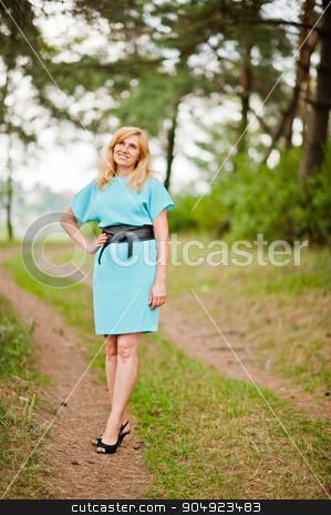 Adult blonde woman posed at pine forest stock photo, Adult blonde woman posed at pine forest by Andrii Shevchuk