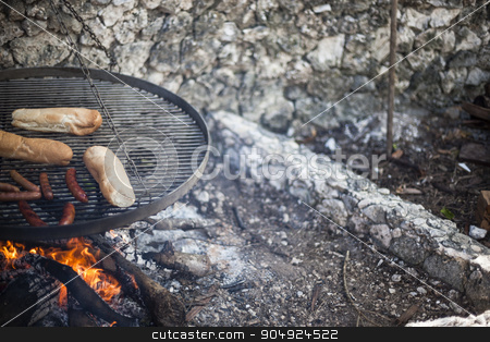 Detail of food on a grill stock photo, Detail of sausages and buns on a small grill by JRstock