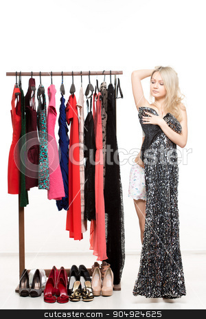 girl in underwear from clothes hangers. Isolated white background. choice of dress stock photo, girl in underwear from clothes hangers. Isolated on white background. choice of dress by Kopytin Georgy