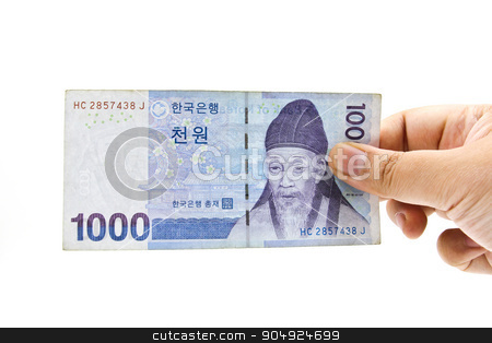 Korean Won currency bills in hand isolated on white background. stock photo, Korean Won currency bills in hand isolated on white background. by doraclub