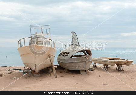 Deserted fishing boats stock photo, Old deserted fishing entertainment boats on the beach of Red Sea by Nikita Buida