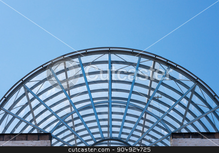 Architectural Details of a Glass and Steel Building stock photo, Detail of steel and glass roof of a modern building with blue clear sky by catalby