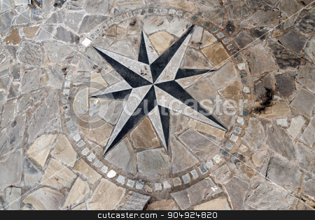 Pavement Stone with Compass Rose stock photo, Stone flooring with compass rose 8 directions. A pier in Liguria harbor, italy by catalby