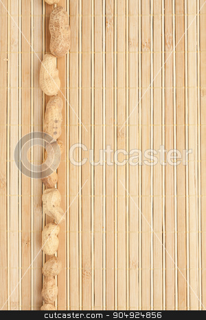 Cases a band of peanut lying on bamboo mat stock photo, Cases a band of peanut lying on bamboo mat, as background by alekleks