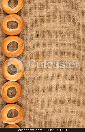 Bagels are on burlap stock photo, Bagels are on burlap with space for text by alekleks