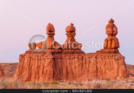 3 Pillars of Moab stock photo, Purple gradient behind red rocks in Moab Utah by Daniel Stewart