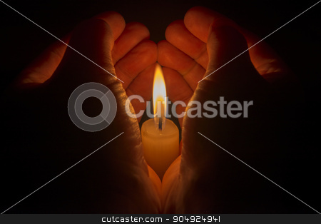 Protective hands around a burning candle stock photo, Protective hands around a burning candle  by Tofotografie