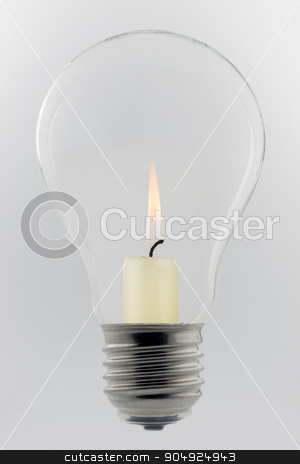 Conceptual glass light bulb with burning candle stock photo, Conceptual glass light bulb with burning candle inside  by Tofotografie